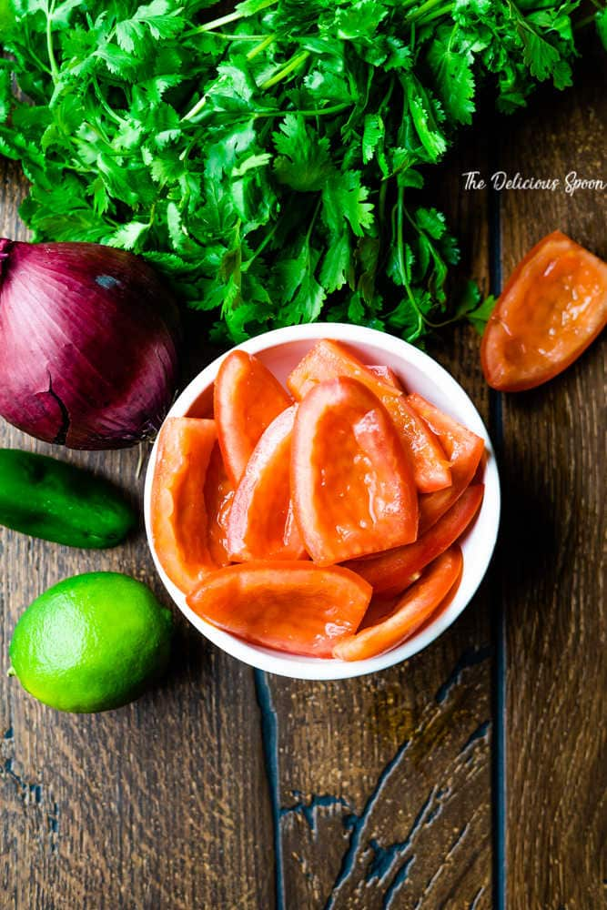 Ingredients for fresh pico de gallo - tomatoes, lime, cilantro, onion, jalepeno