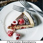 Pinterest pin showing a piece of raspberry chocolate cheesecake on a white plate with two forks