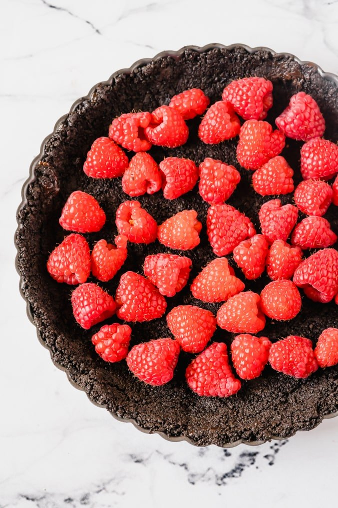 A chocolate tart filled with fresh raspberries