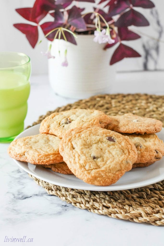 Chocolate Chip Cookies on a plate with a big glass of milk in a green cup