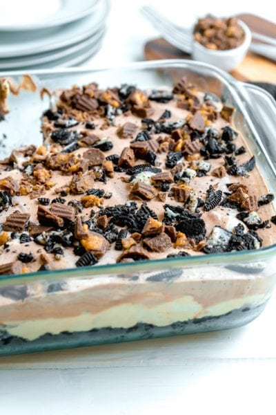 A close up showing the layers of a no bake chocolate peanut butter dessert.