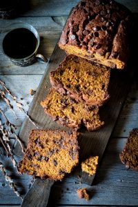 Overhead picture of an easy recipe for pumpkin bread with chocolate chips sliced on cutting board