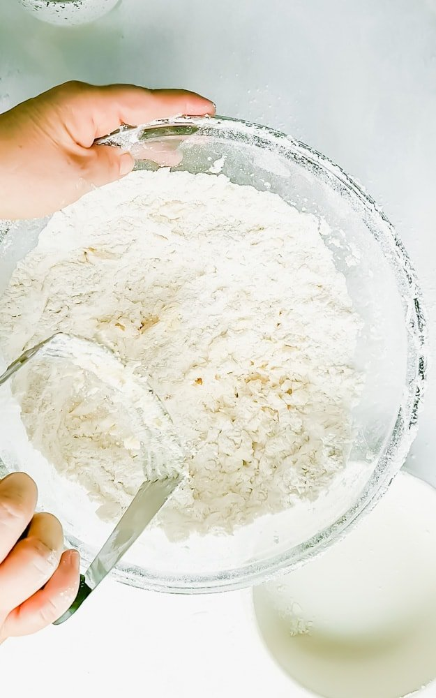 Flour and butter being cut with a pastry cutter