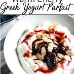 bowl of greek yogurt and cherries
