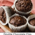 A pile of Double Chocolate Banana Muffins on a cutting board