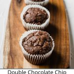 Double Chocolate Chip Banana Muffins on a cutting board