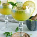 Kombucha cocktails served in large margarita glasses