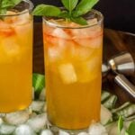 Chilcano recipe served in tall glasses with a sprig of mint