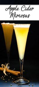 Two apple cider mimosa cocktails back lit on a black background