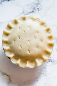 Small unbaked homemade pie with fluted edges