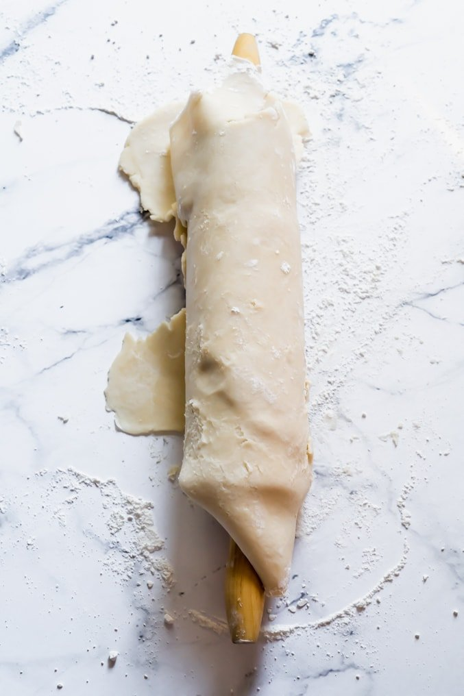Homemade pie crust wrapped around a rolling pin
