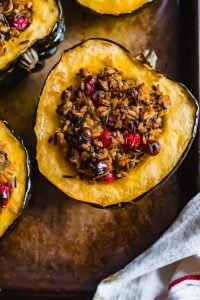 Baked Acorn Squash stuffed with wild rice, cranberries and pistachios