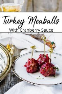 Pinterest pin for baked turkey meatballs glazed in cranberry sauce on silver platters and white side plates.
