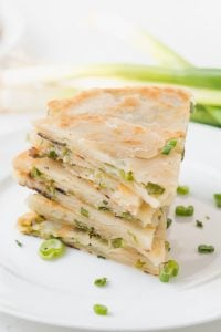 Close up of a stack of cut Scallion Pancakes