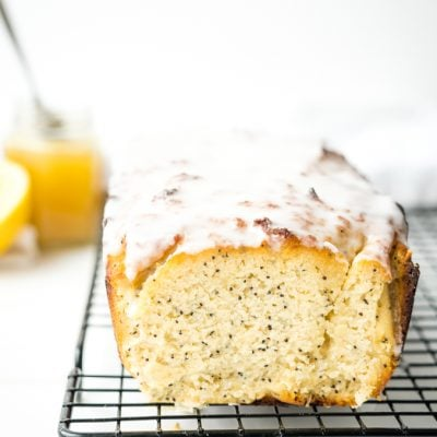 A lemon poppyseed bread on a wire rack