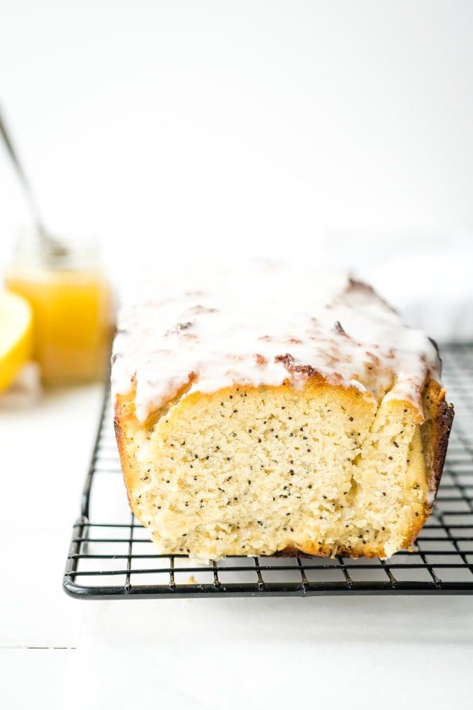 A lemon poppyseed bread on a wire rack