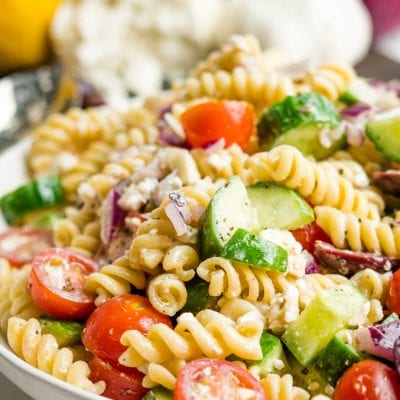 A bowl of Greek Pasta salad close up
