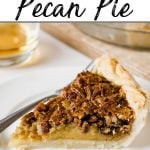 A classic pecan pie slice made with chocolate and bourbon on a white plate.