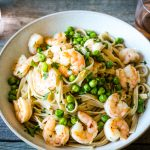 Overhead bowl of a spicy shrimp recipe with pasta and peas
