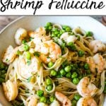 Pinterest pin of a shrimp pasta dish with green peas.