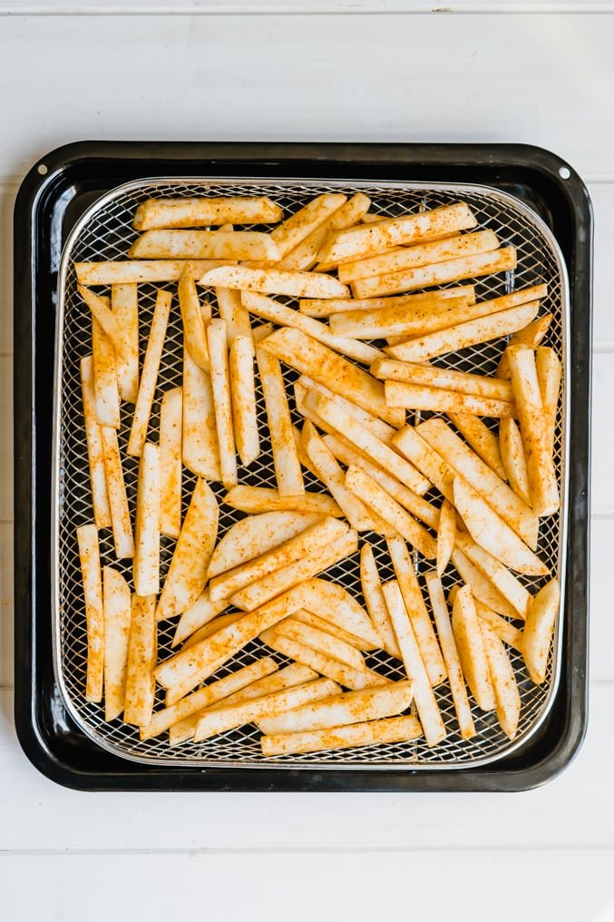 A basket of unbaked turnip fries ready to be air-fried