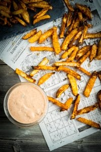 Turnip french fries on newspaper with dipping sauce