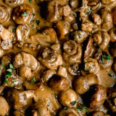 Close up of sauteed mushrooms in a creamy garlic sauce.