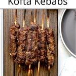 Pinterest pin showing a platter of grilled kofta kebobs.