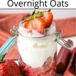 Pinterest pin showing a jar of strawberry overnight oatmeal with fresh rhubarb and strawberries on a white table with red napkin in behind