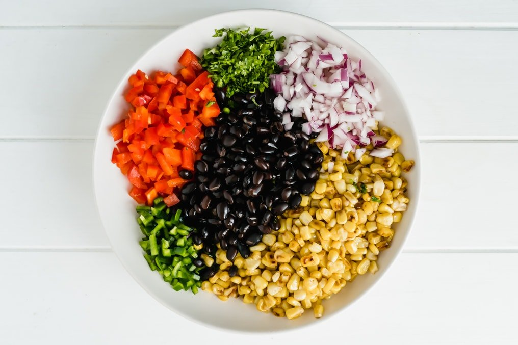Bowl of mexican street corn salad ingredients
