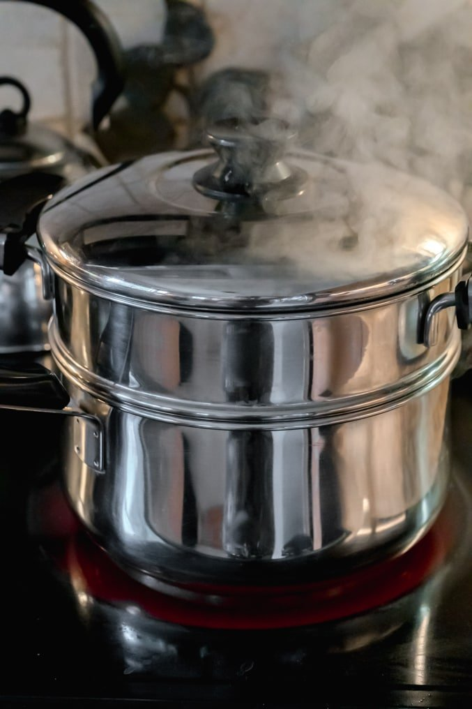 A double boiler on the stove