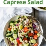 Pinterest pin showing a white bowl filled with fresh caprese salad