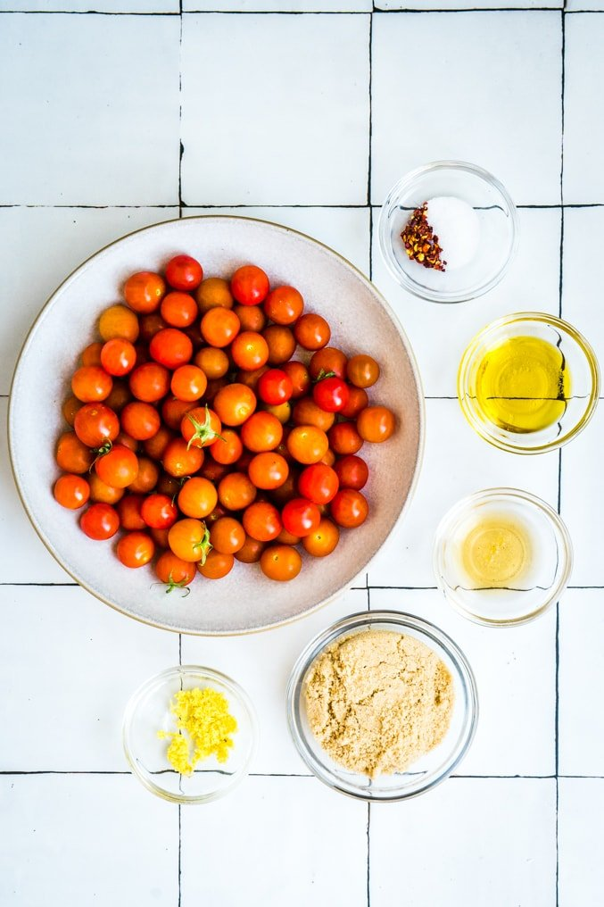 Tomato jame ingredients on a white tile table