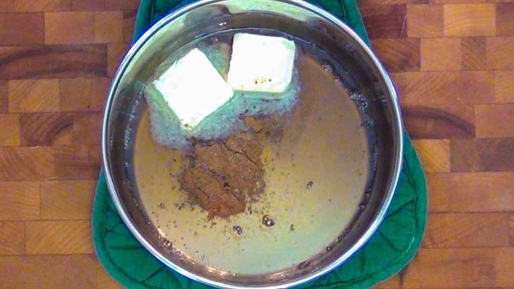 Butter, cinnamon and spiced rum in a pot to make a butter rum glaze
