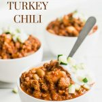 Pinterest pin showing 3 bowls of healthy turkey chili topped with sour cream and diced zucchini