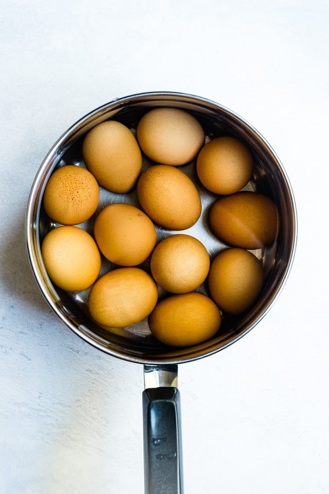 A pot of brown eggs for boiling