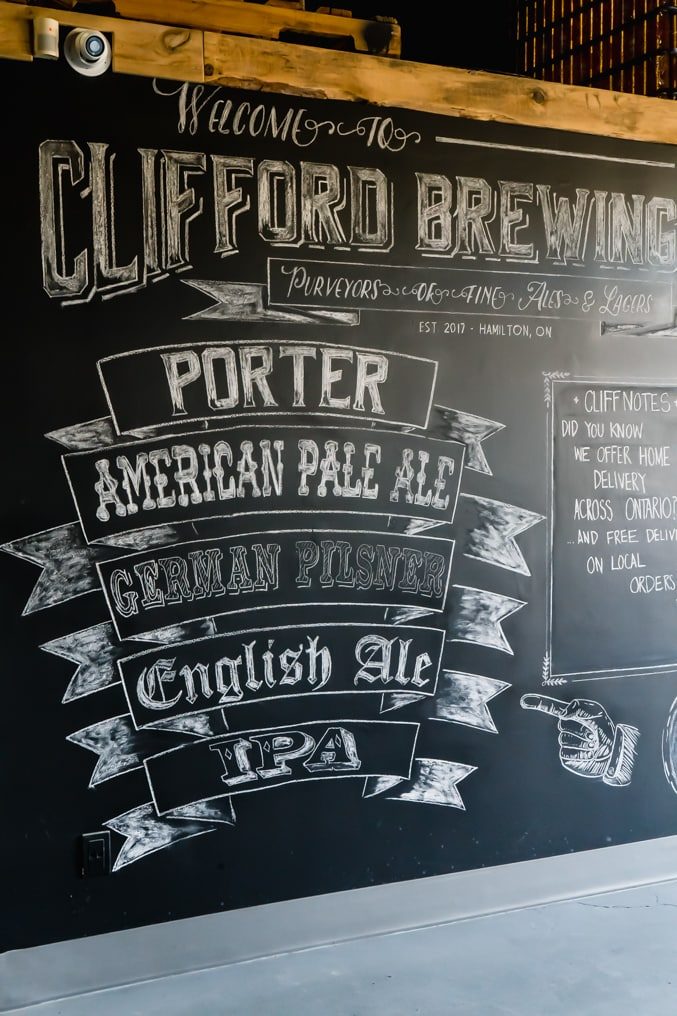 List of beers available at a local Hamilton brewery on a chalk wall