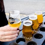 A flight of craft beers near me on an outdoor patio.