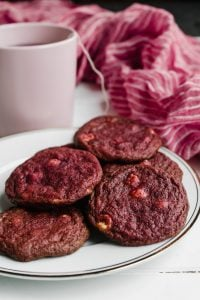 A plate of red velvet white chocolate chip cookies