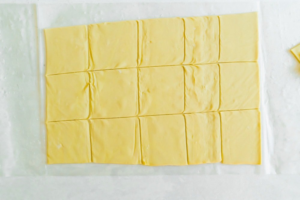 Raw puff pastry cut into squares
