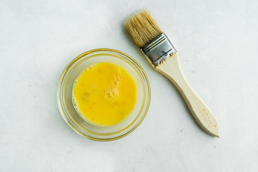 Egg wash and a basting brush