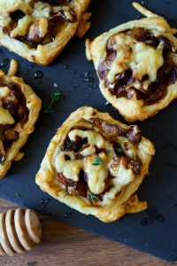Mushroom tarts baked and topped with cheese and honey