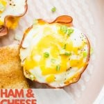 Pinterest pin showing one ham and cheese egg cup topped with sliced green onions.