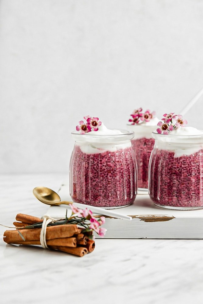 Small jars filled with a healthy chia seed pudding made with beetroot powder