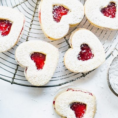 A Valentine's Day cookie idea showing cut out raspberry jam filled cookies.
