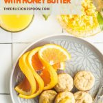 Pinterest pin showing baby banana pancakes on a plate with oranges and honey butter.