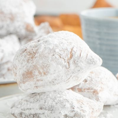 A stack of two New Orleans Style Beignets on a plate