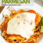 A Pinterest pin showing a baked low carb chicken parmesan over a bed of pasta.