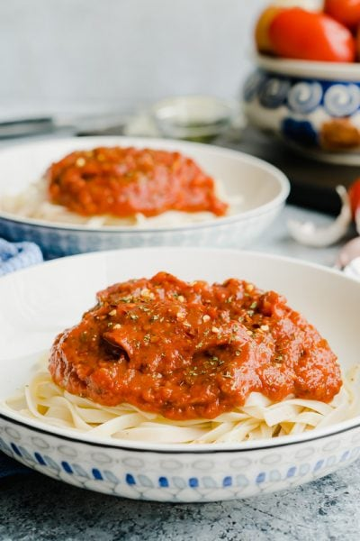 Marinara Sauce piled high on top of a bed of pasta.
