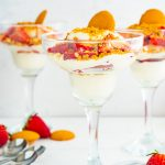 Three dessert cups made with no-bake cream cheese filling and topped with strawberries.